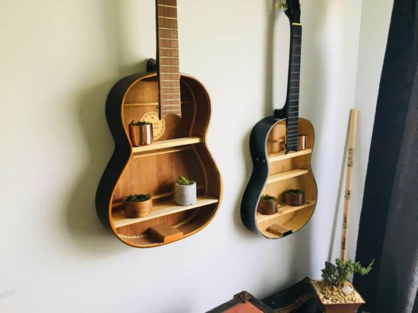 upcycled guitars made into bookshelves